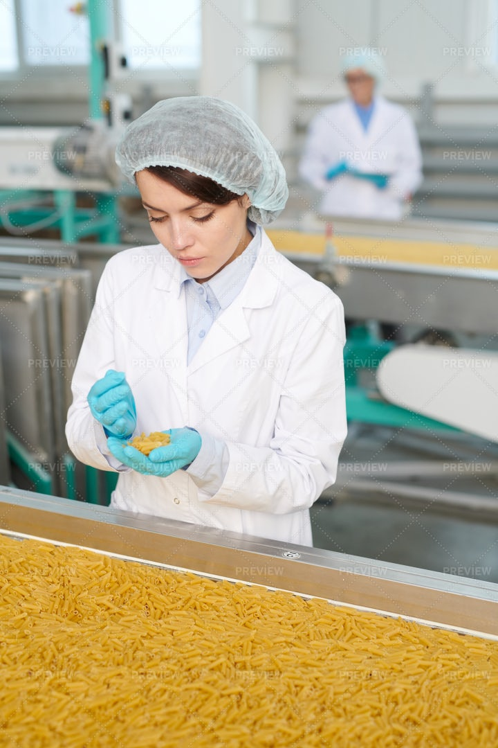 Young Woman At Production Line: Stock Photos