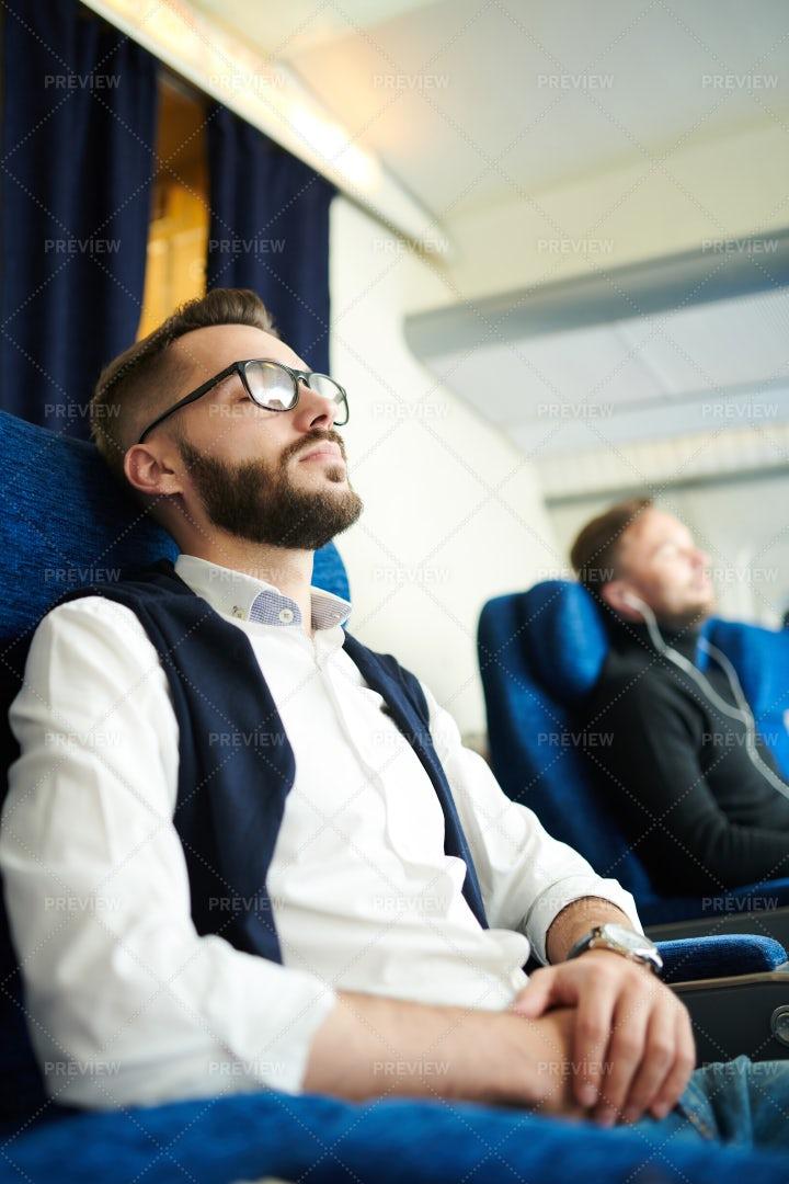 Young Man Sleeping In Plane: Stock Photos