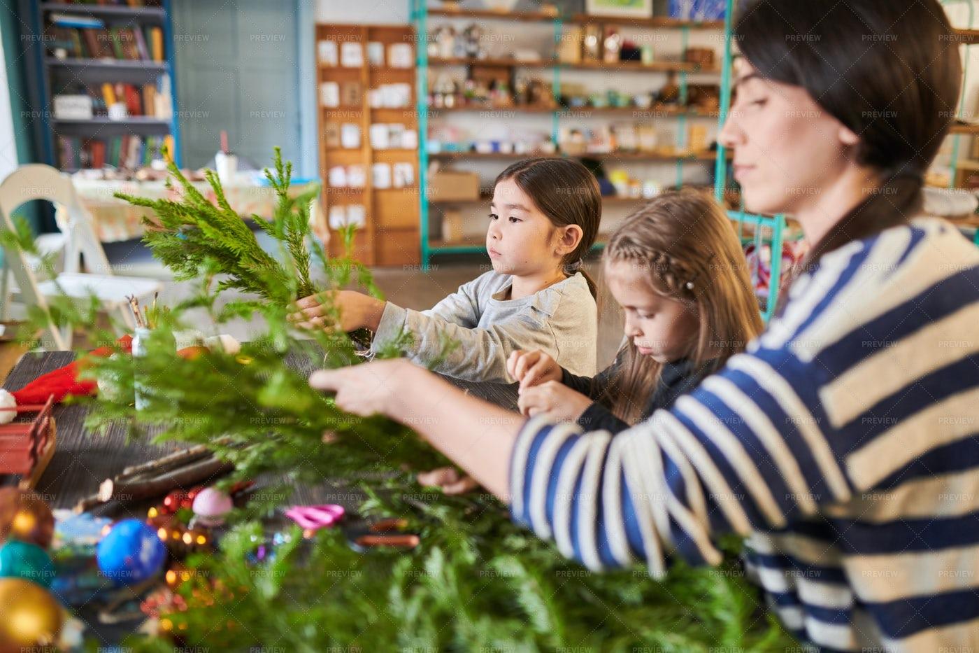 Kids Making Christmas Wreaths: Stock Photos