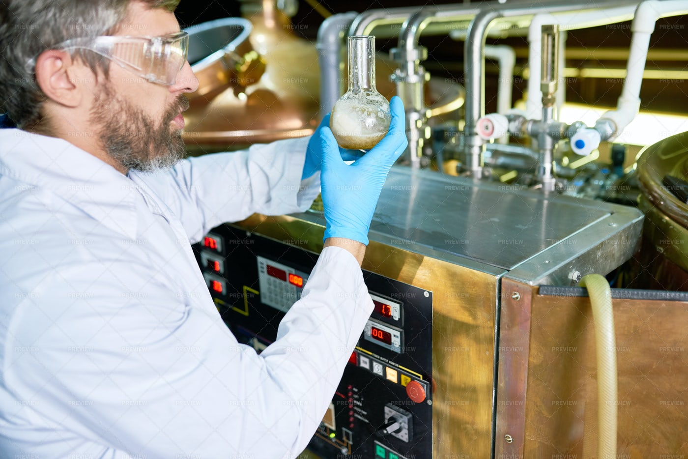 Bearded Brewer Checking Beer...: Stock Photos