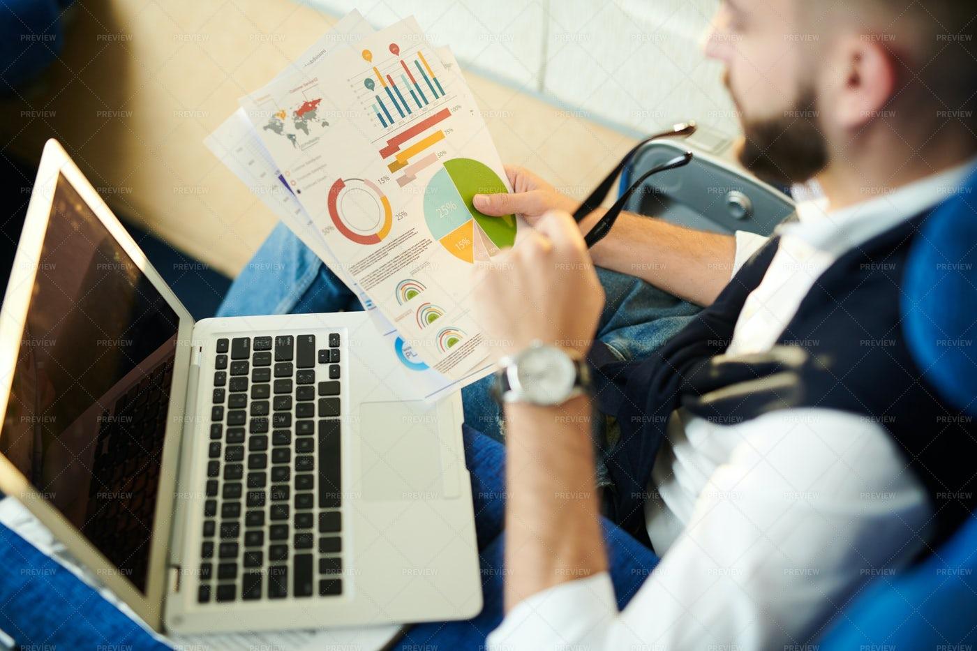 Businessman Studying Graph: Stock Photos