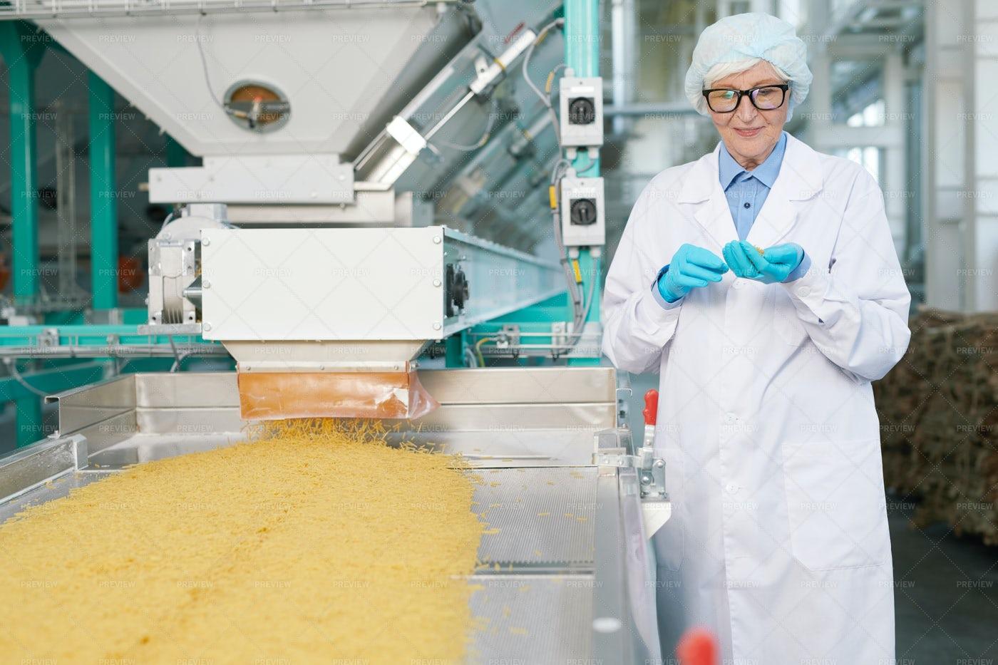 Smiling Senior Woman At Production...: Stock Photos
