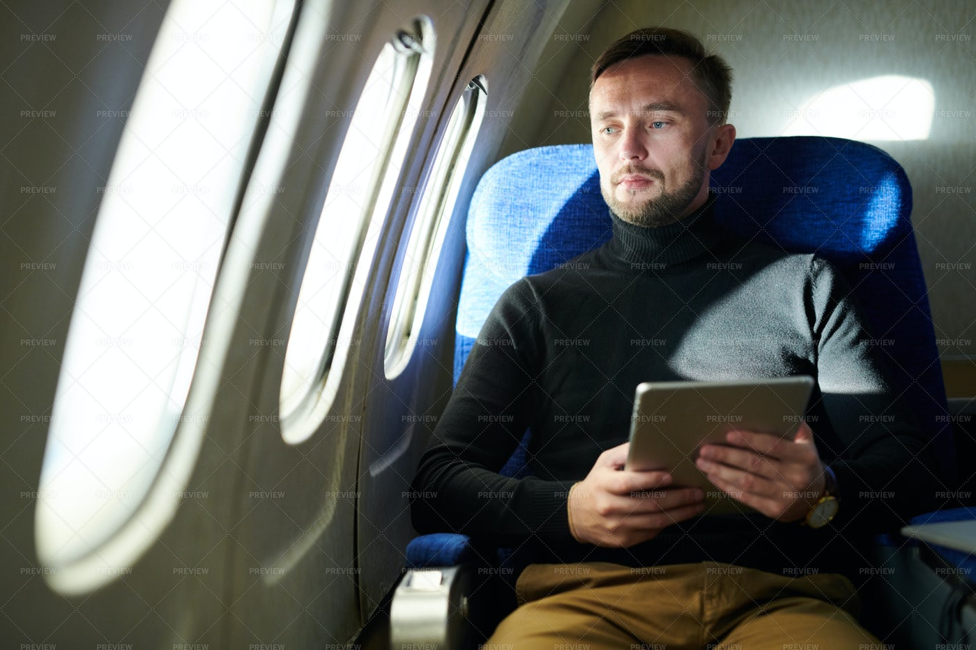 Pensive Man Holding Tablet In...: Stock Photos