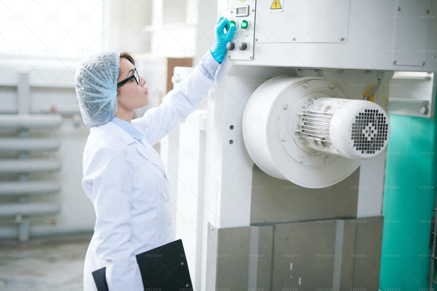 Young Woman Setting Factory Machine: Stock Photos
