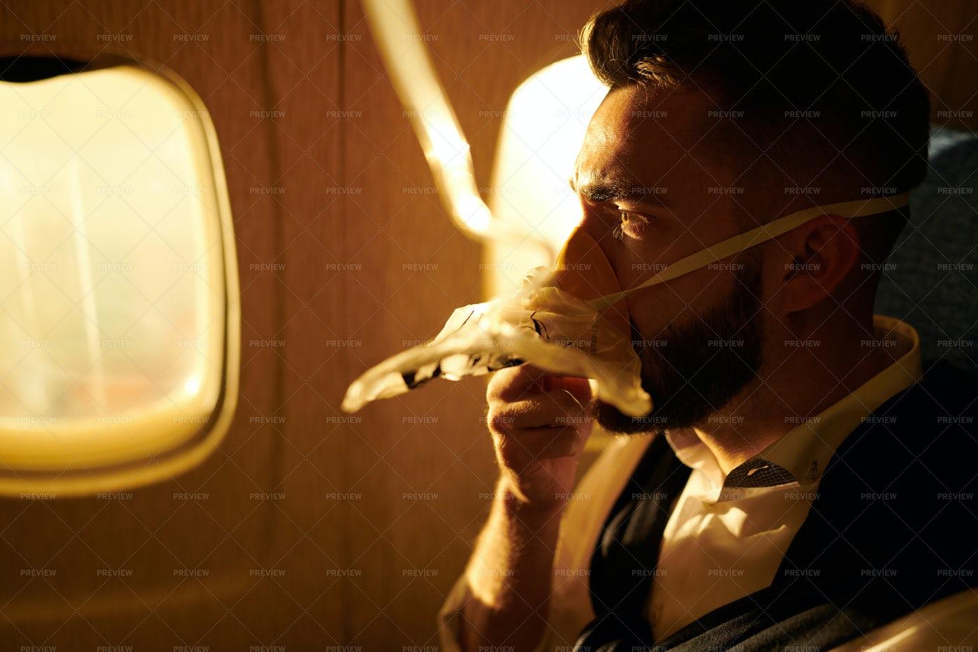 Man Breathing Oxygen In Plane: Stock Photos