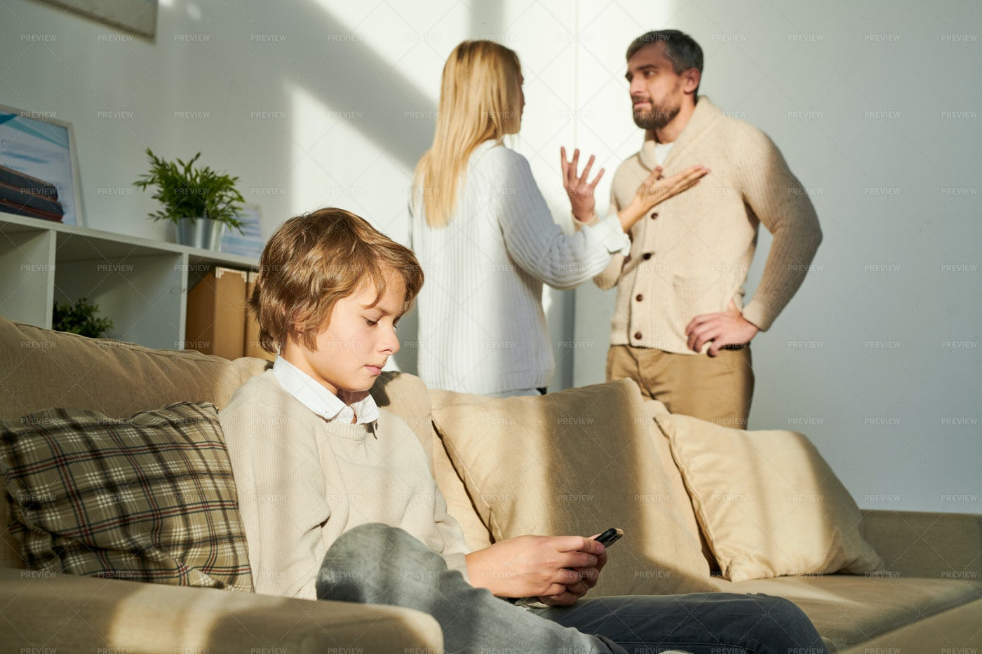 Boy Being Closed Off While Parents...: Stock Photos