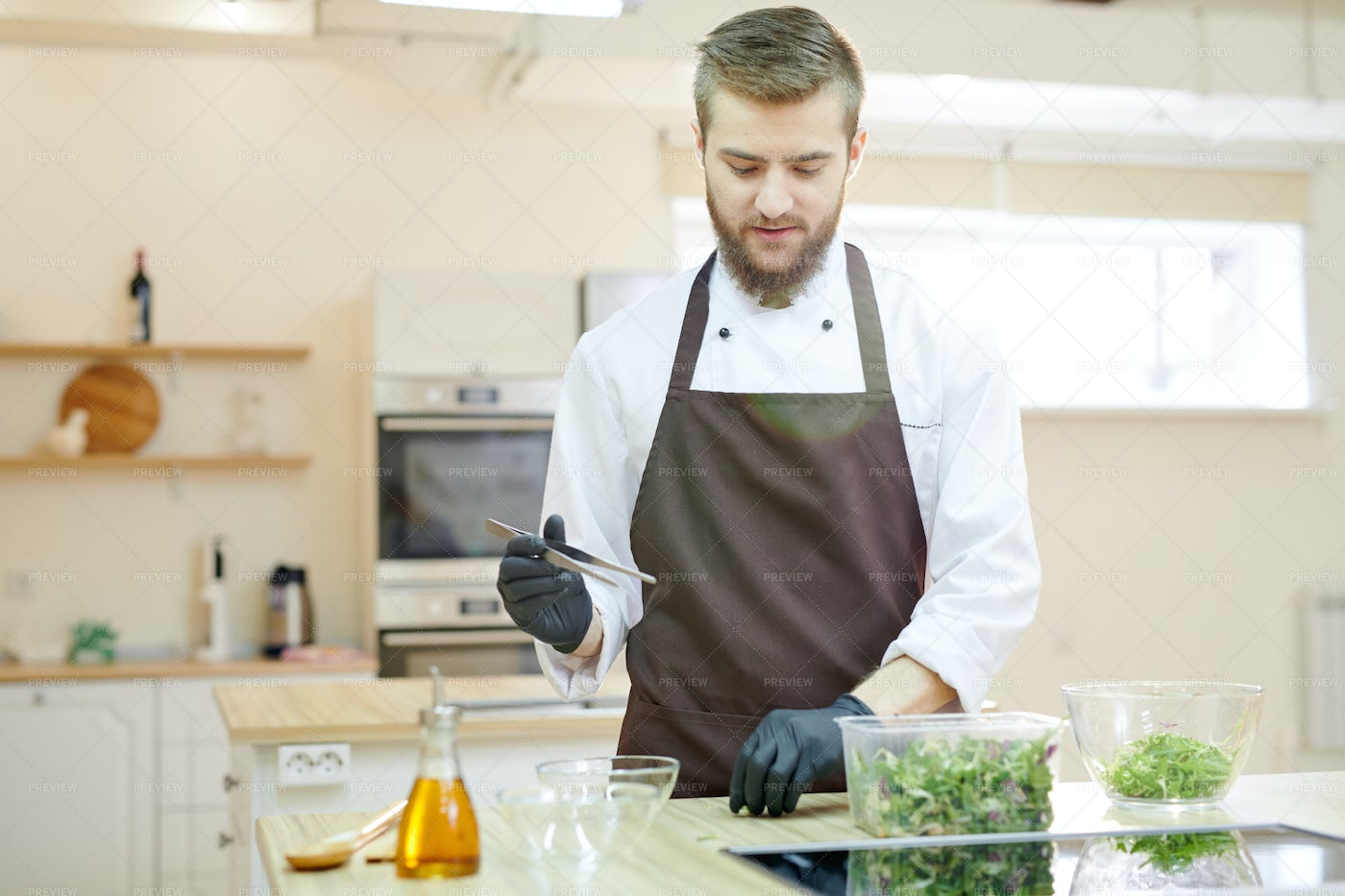 Professional Chef Cooking In...: Stock Photos