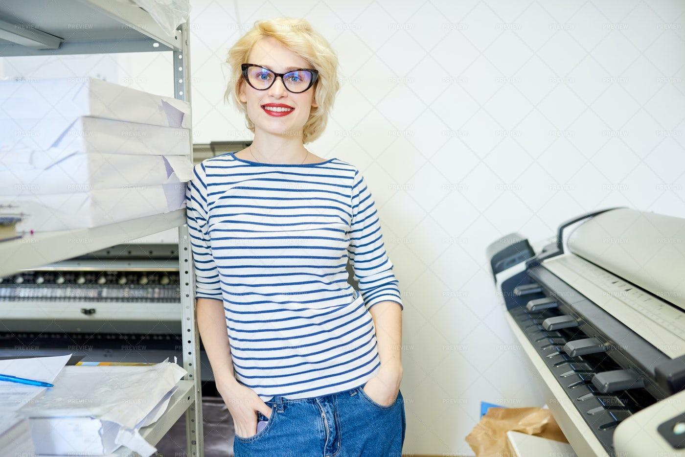 Young Woman Posing In Printshop: Stock Photos