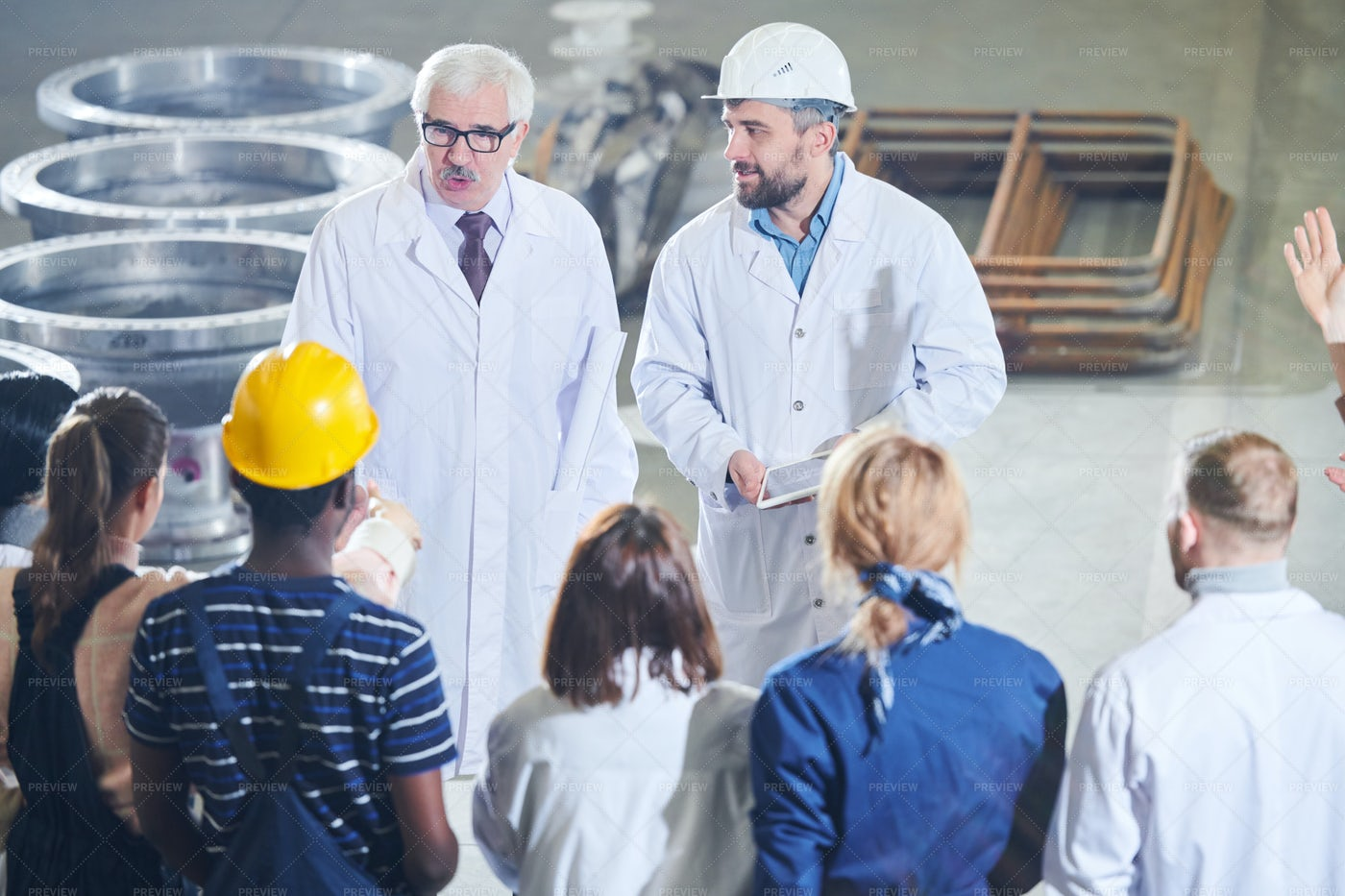Workers Meeting With Factory...: Stock Photos