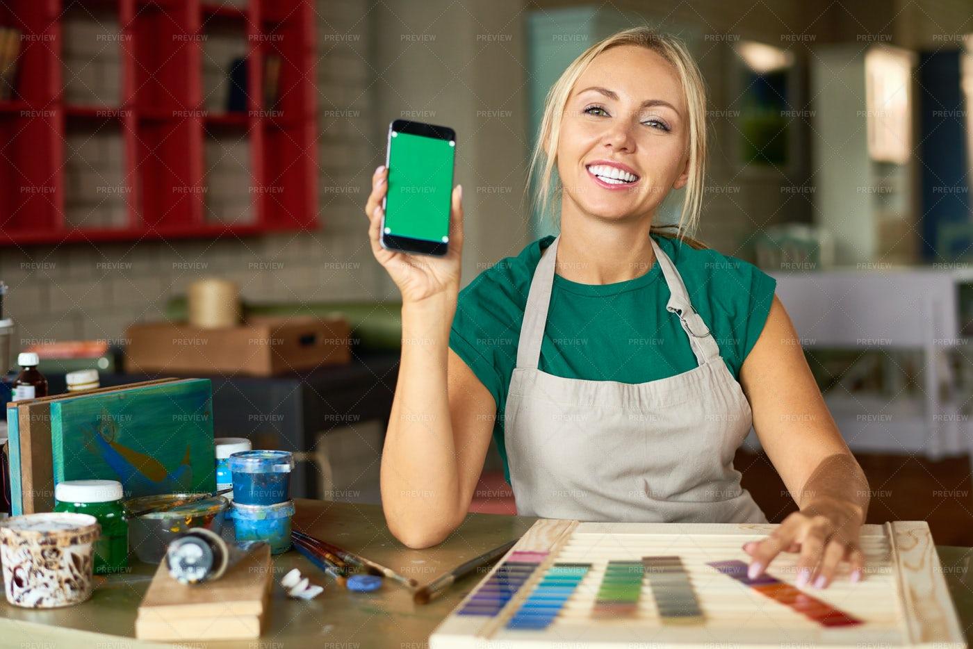 Female Artist Presenting Mobile App: Stock Photos