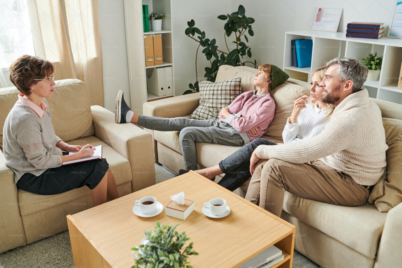 Worried Parents Asking Question To...: Stock Photos