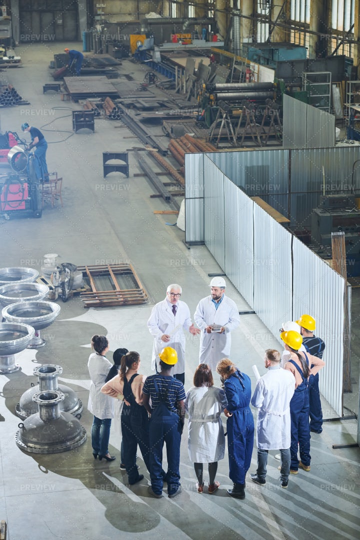 Factory Workers Meeting With...: Stock Photos