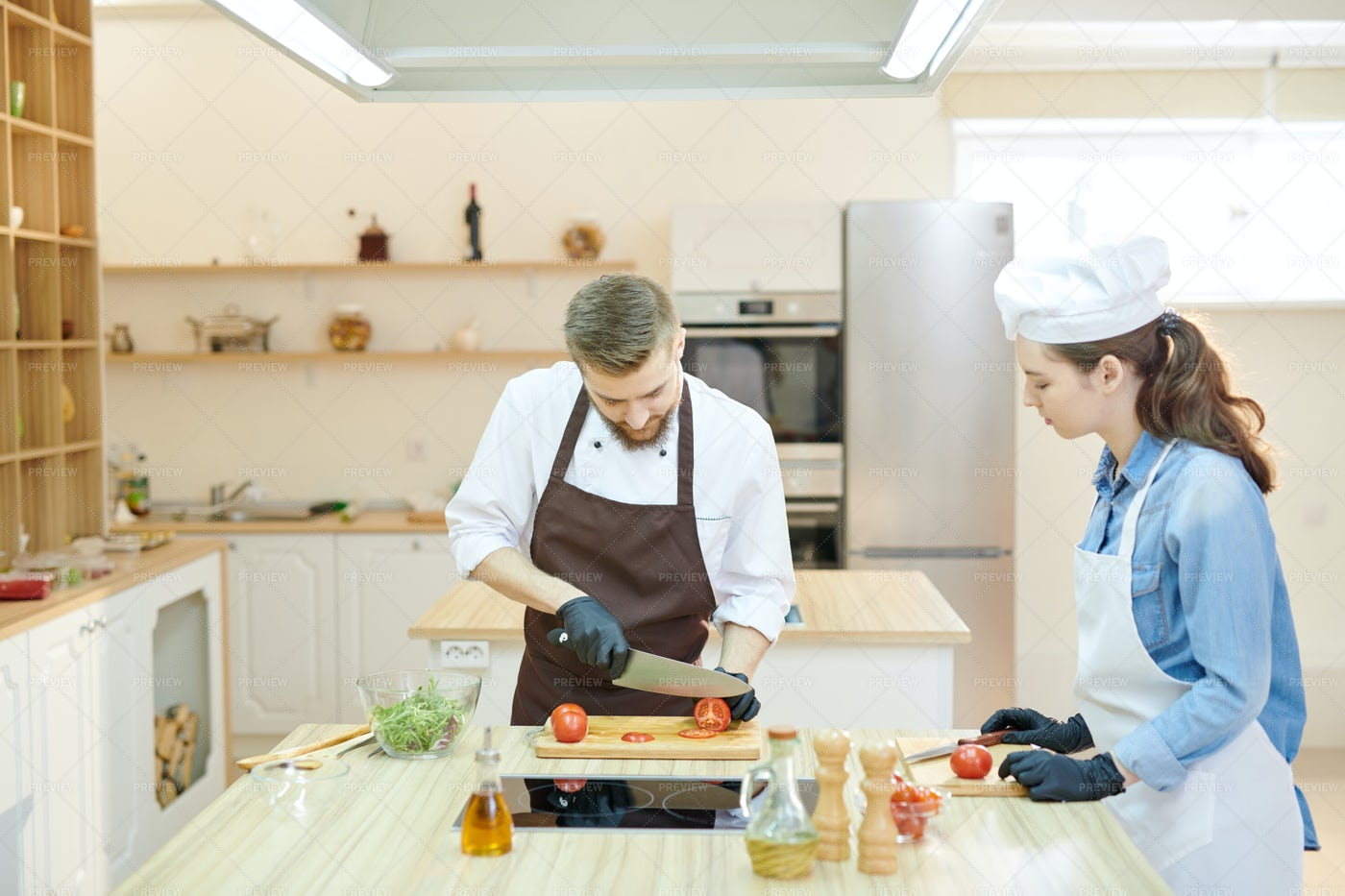 Two Professional Chefs Cooking In...: Stock Photos