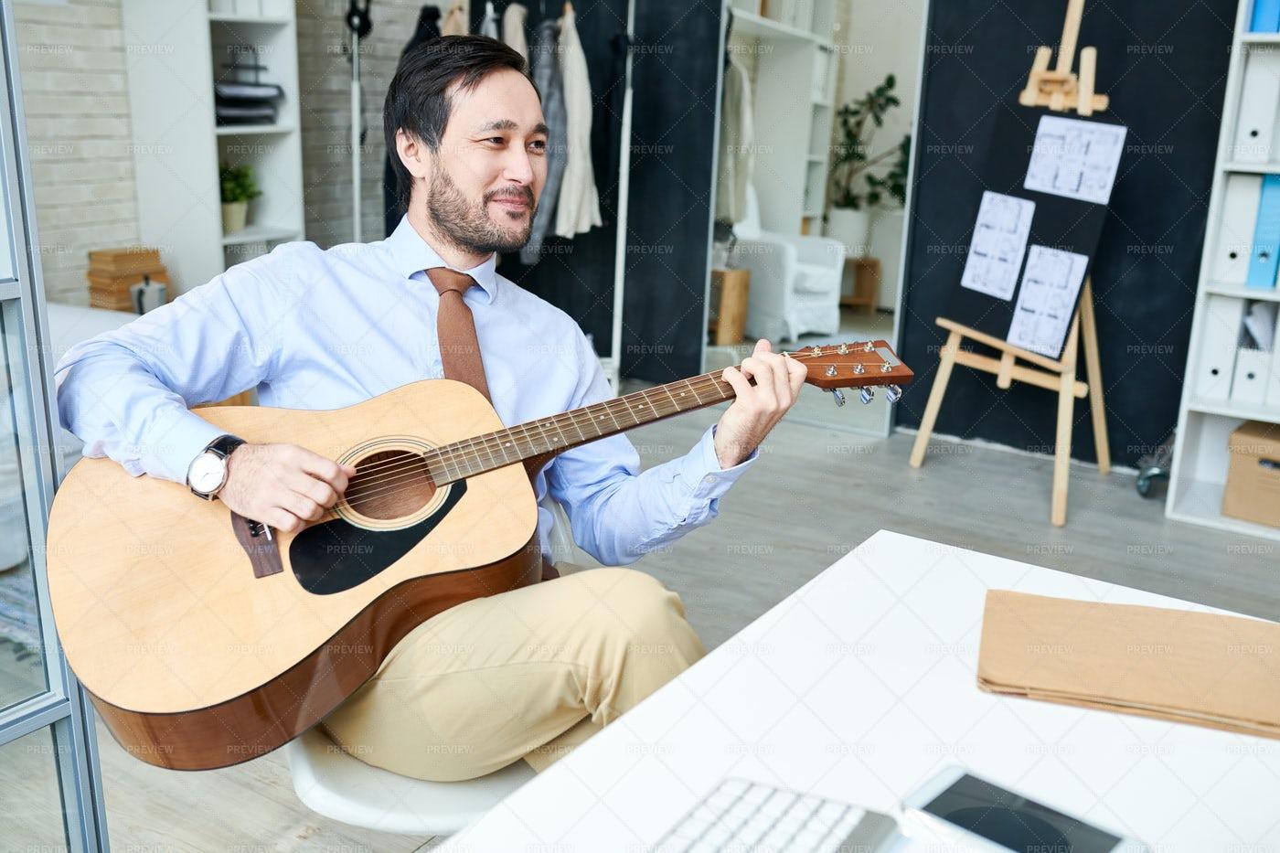 Handsome Man Enjoyin Guitar In...: Stock Photos