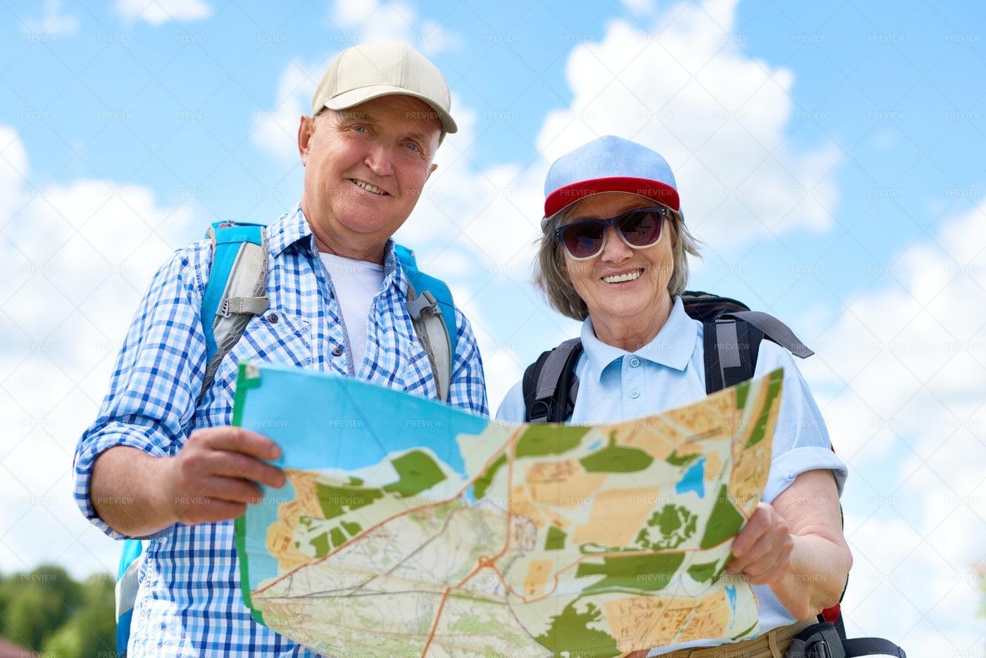 Happy Senior Tourists Holding Map: Stock Photos