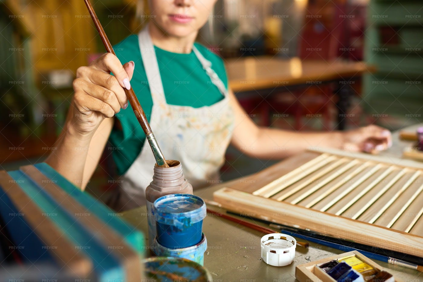 Young Woman Painting DIY Project In...: Stock Photos