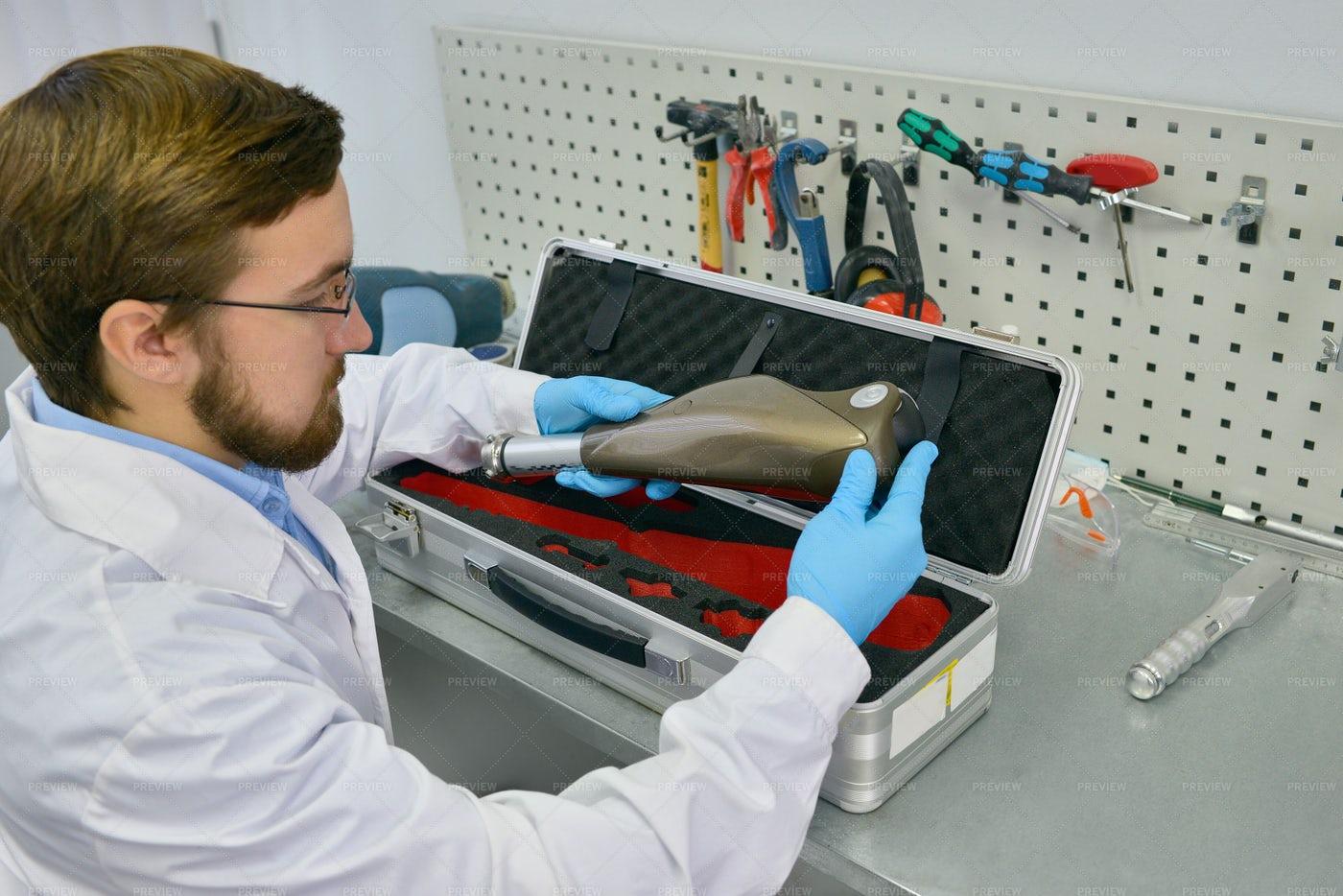 Prosthetics Technician Checking...: Stock Photos