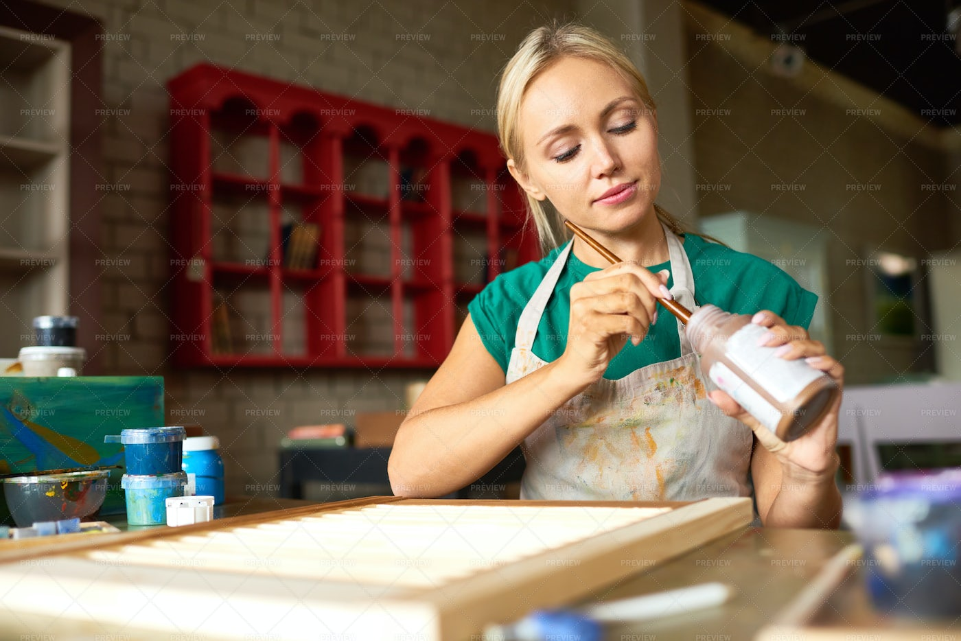 Pretty Young Woman Working In Art...: Stock Photos