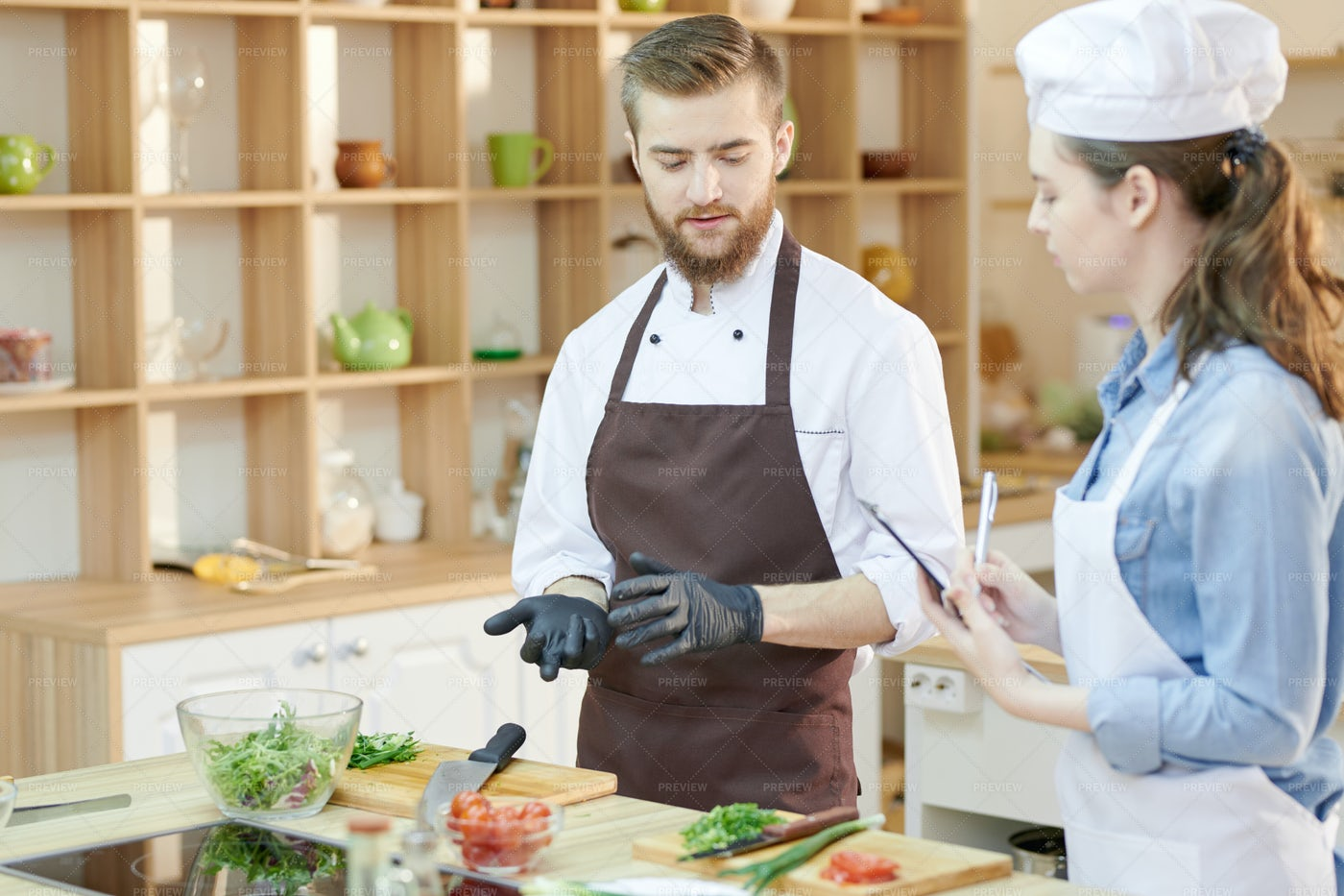 Two Young Chefs In Restaurant...: Stock Photos