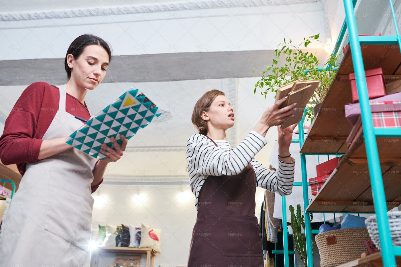 Women Decorating Store For...: Stock Photos
