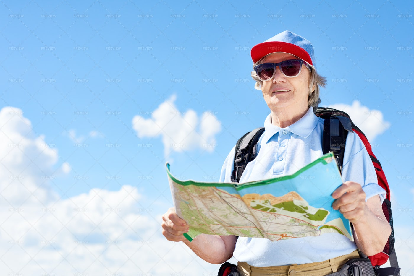 Active Senior Woman Holding Map: Stock Photos