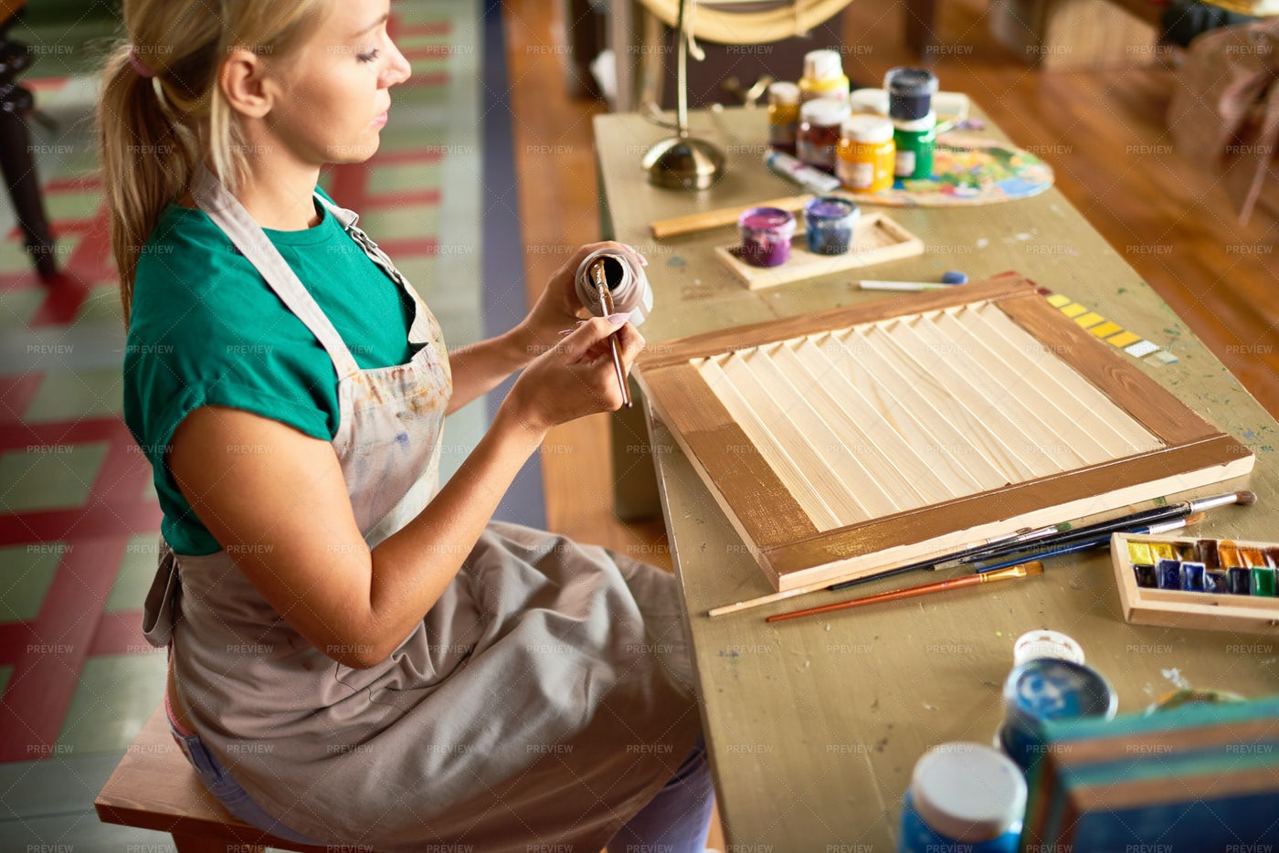 Young Female Artist Working In...: Stock Photos