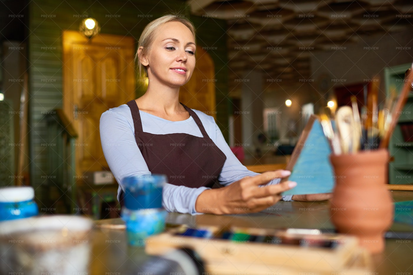 Smiling Artist Looking At Her...: Stock Photos