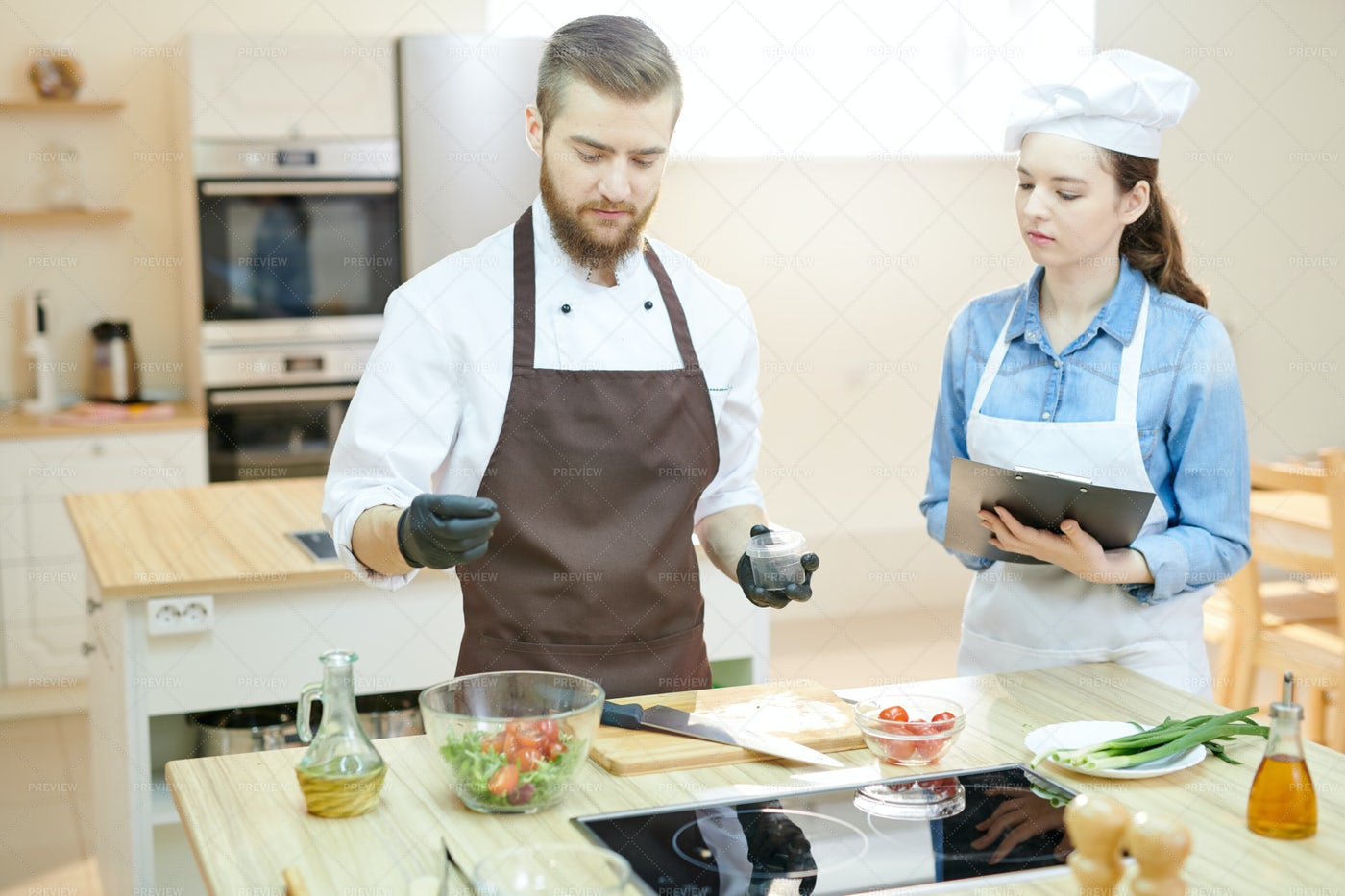Young Professional Chef Working In...: Stock Photos