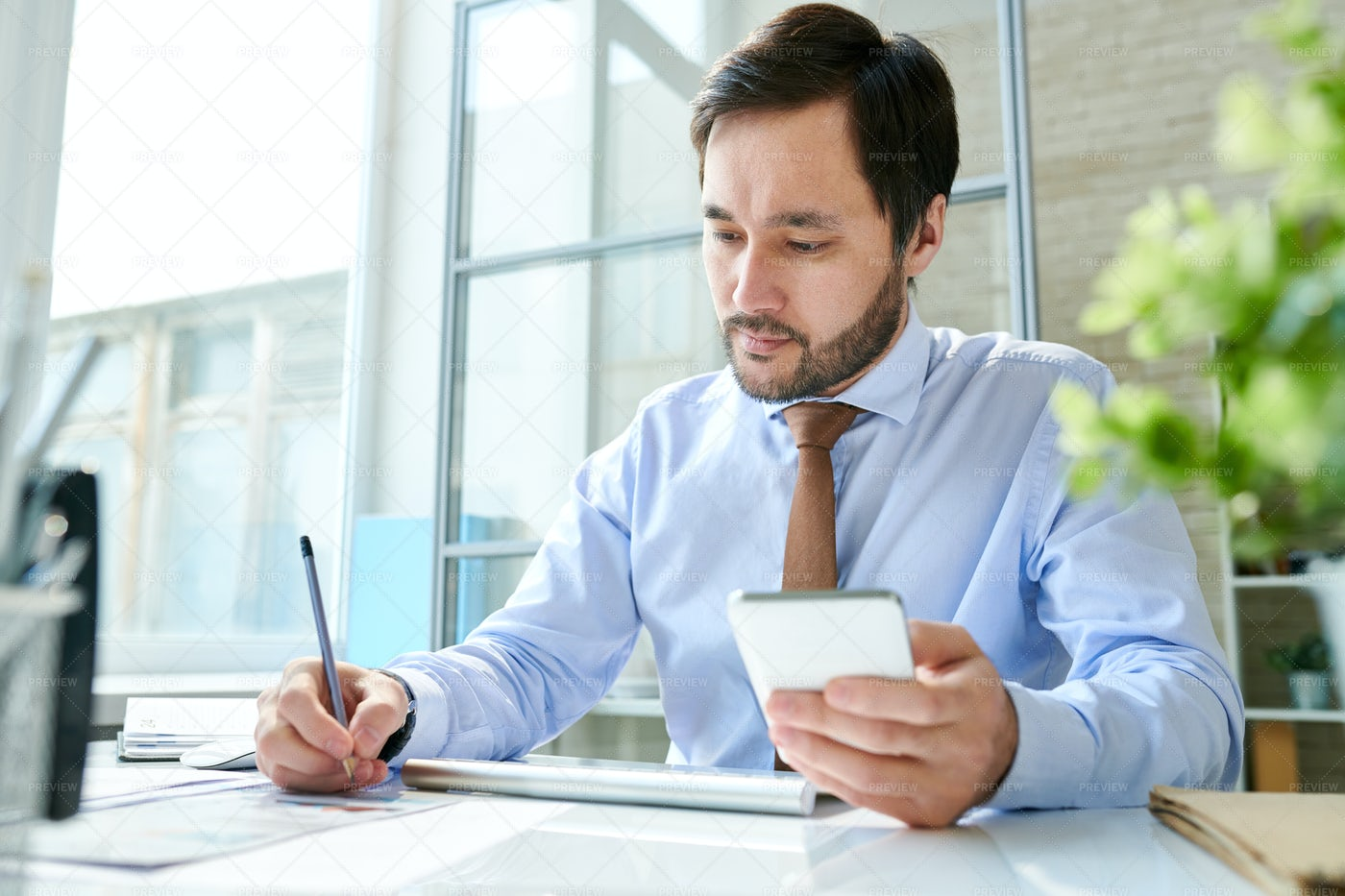 Employee Working With Smartphone In...: Stock Photos