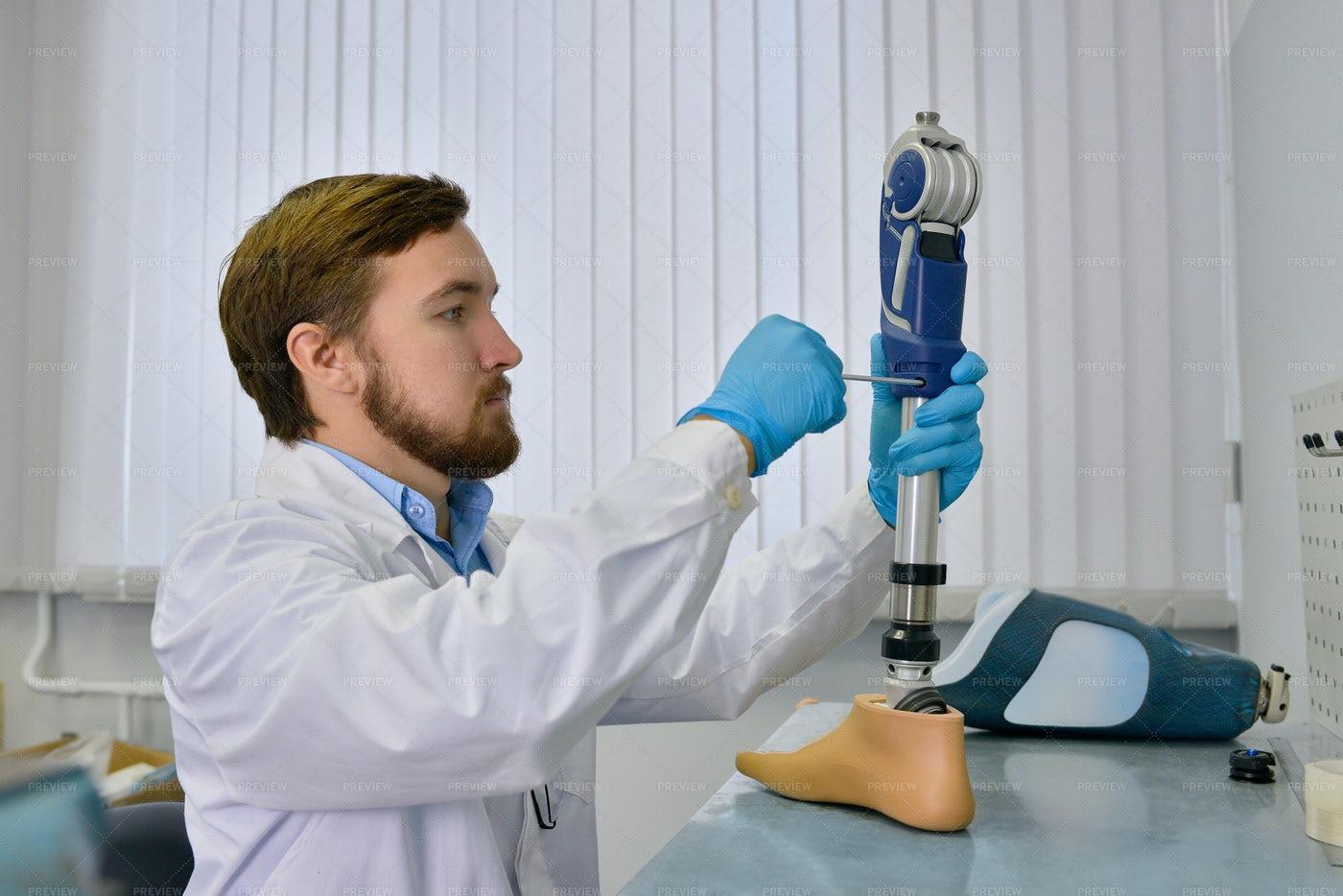 Prosthetist Repairing Artificial...: Stock Photos