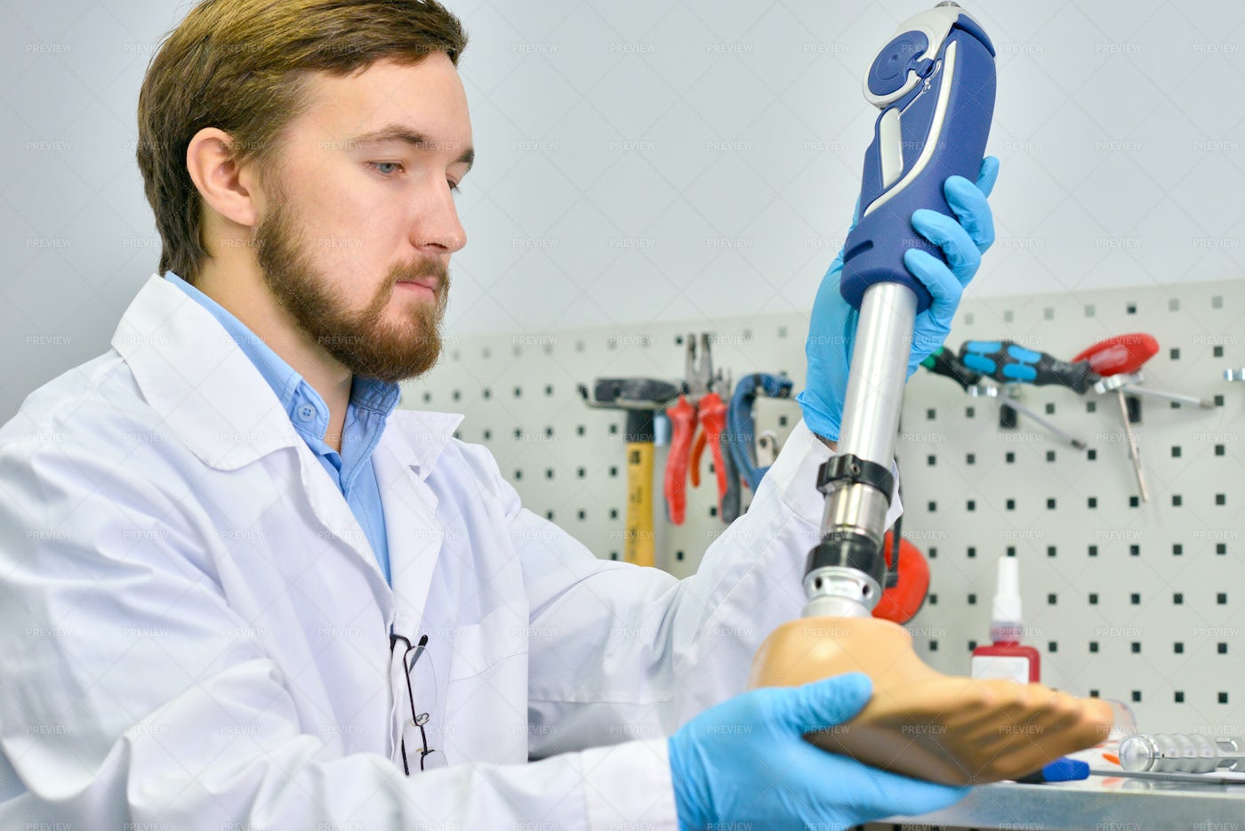 Young Prosthetist Holding ...: Stock Photos