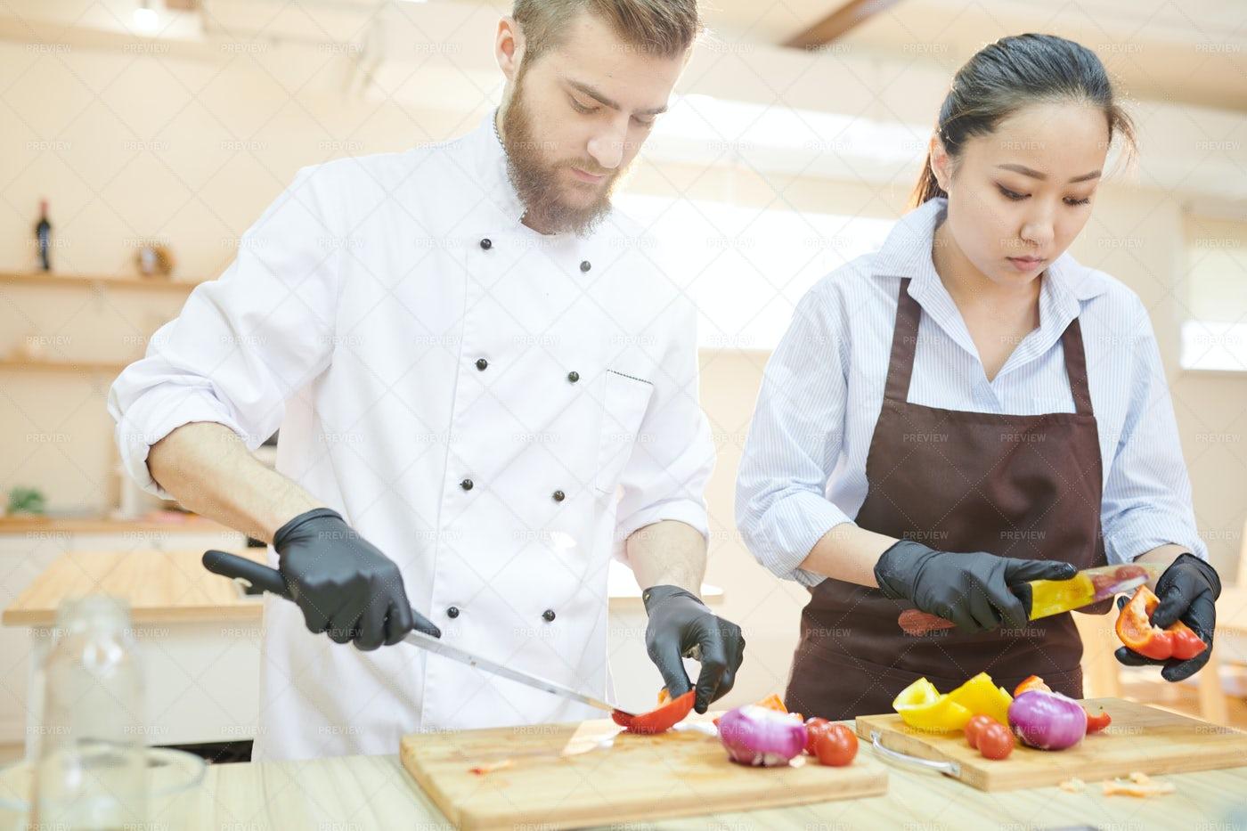 Two Modern Chefs Working In Kitchen: Stock Photos