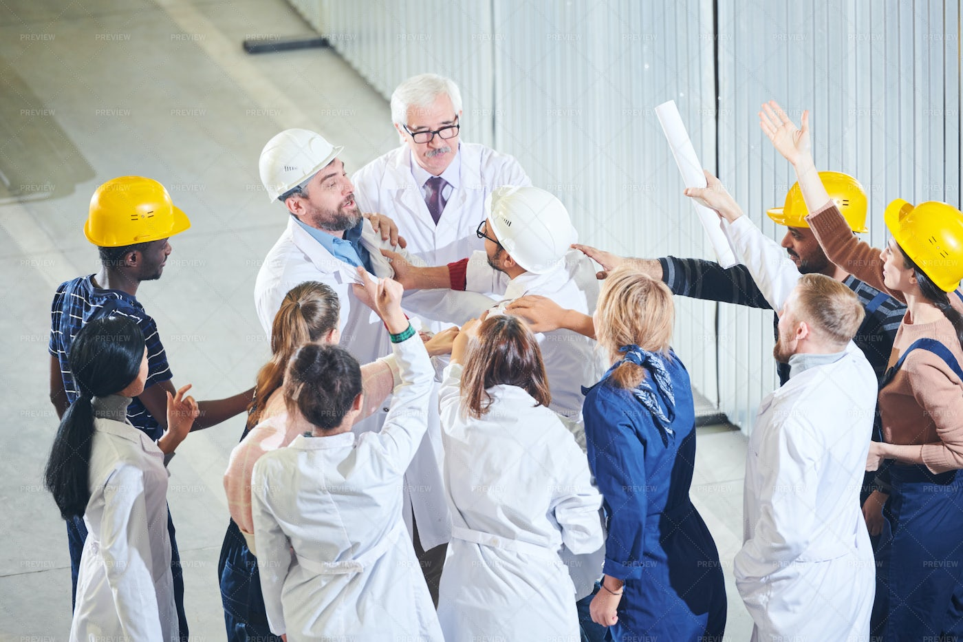 Group Of  Emotional Factory Workers...: Stock Photos