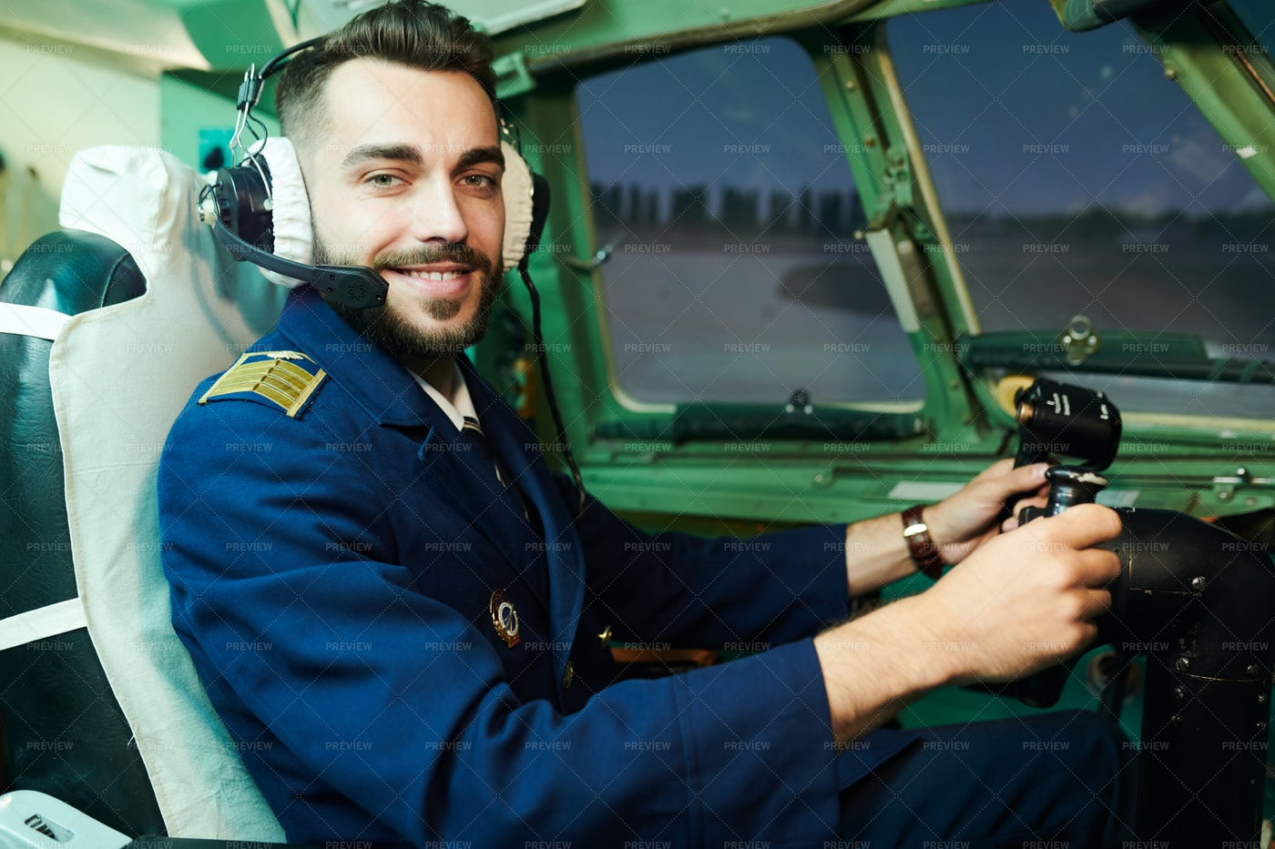 Smiling Pilot In Airplane: Stock Photos