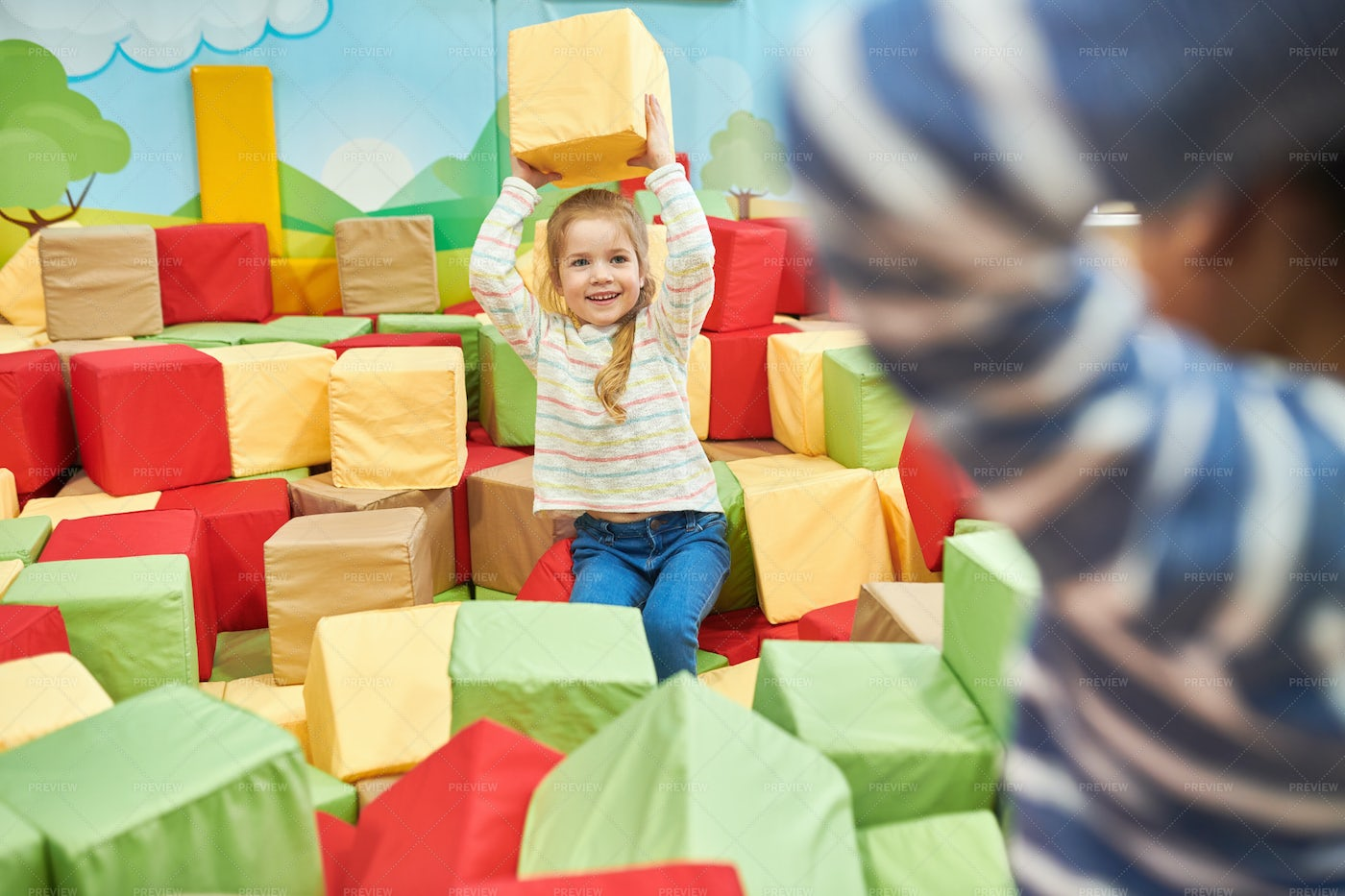 Two Kids Playing In Foam Pit: Stock Photos