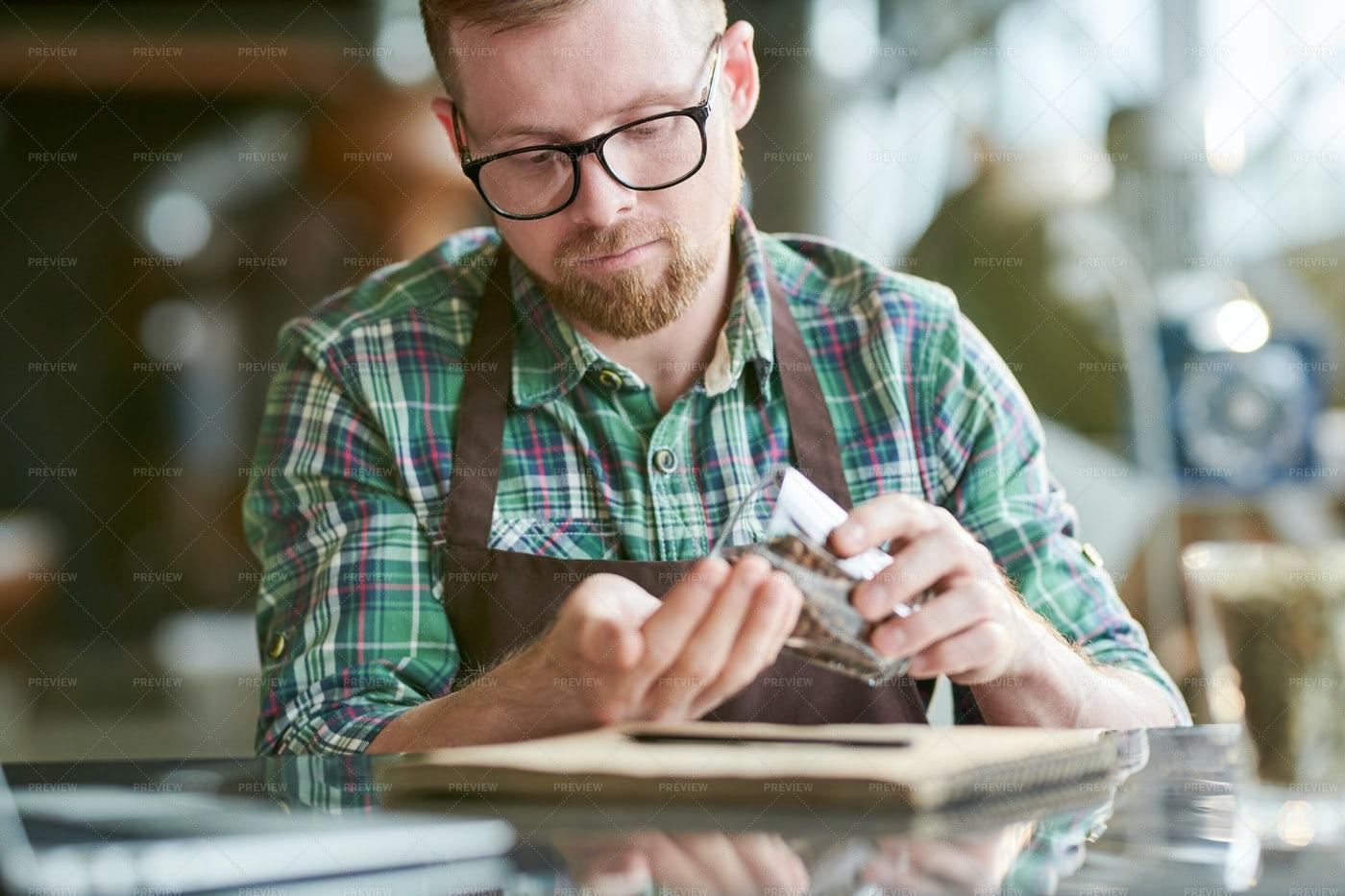 Modern Barista Examining Coffee...: Stock Photos
