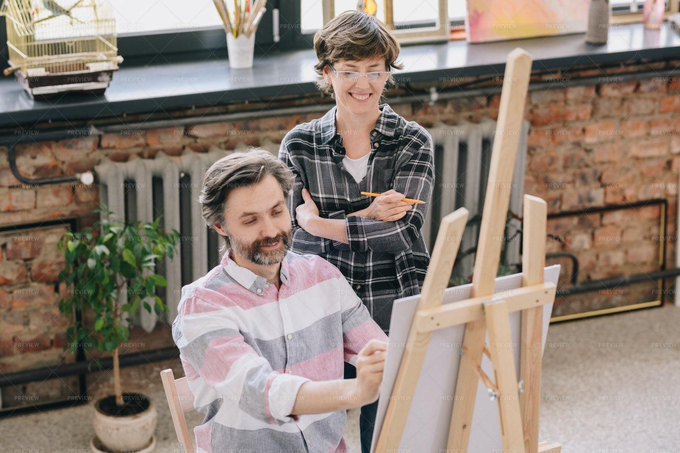 Mature Man Enjoying Art Class: Stock Photos