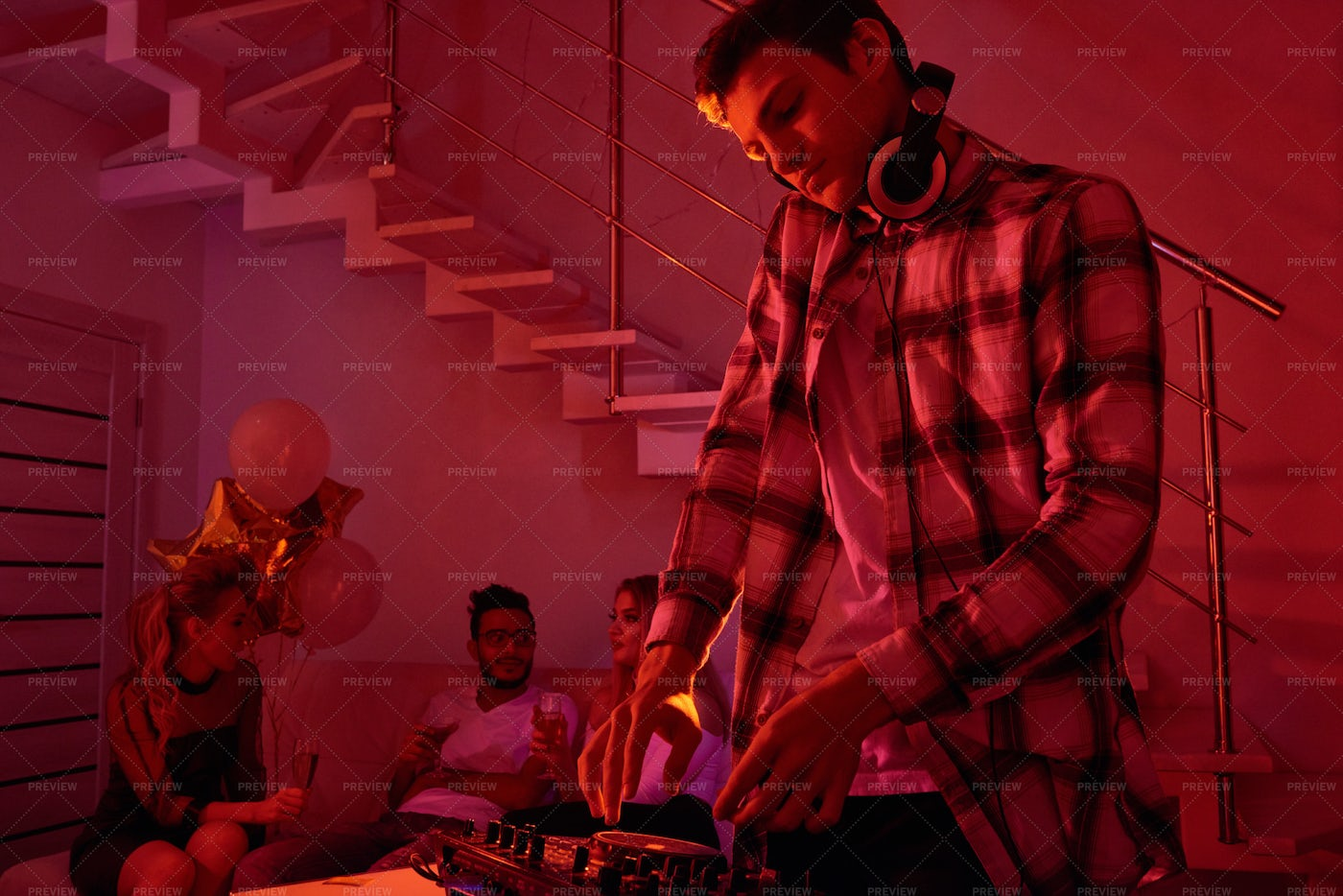 Man Mixing Music On Christmas Party: Stock Photos