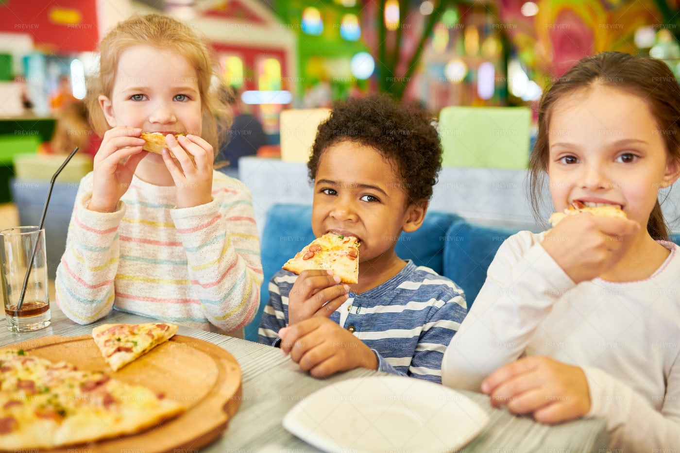 Children Eating Pizza In Cafe: Stock Photos