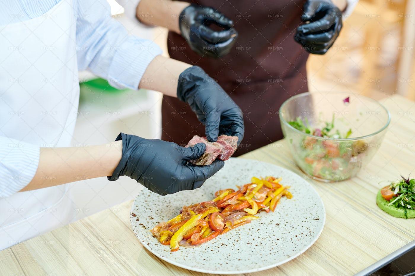 Chefs Plating Dish: Stock Photos