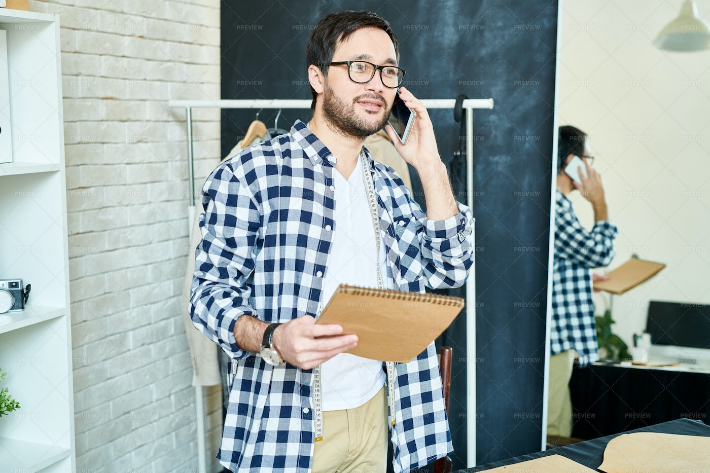 Man In Atelier Talking To Client On...: Stock Photos