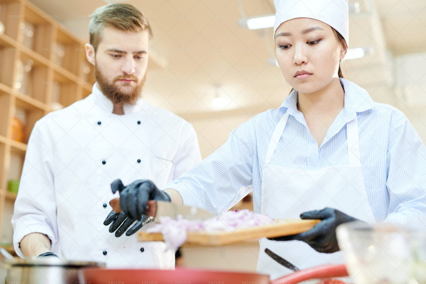 Two Chefs Working In Cafe Kitchen: Stock Photos