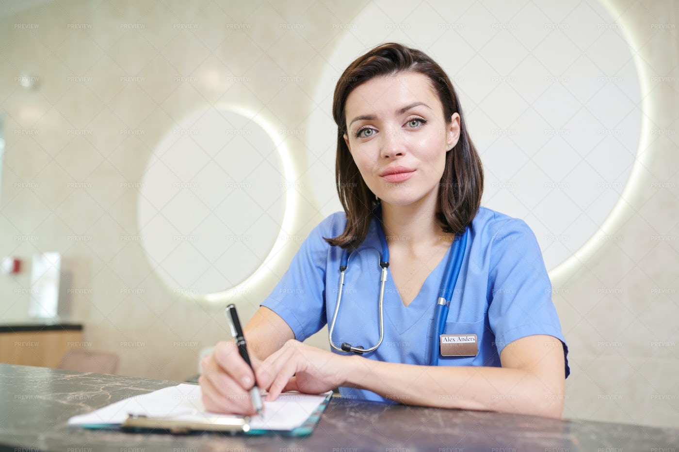 Female Doctor At Desk: Stock Photos