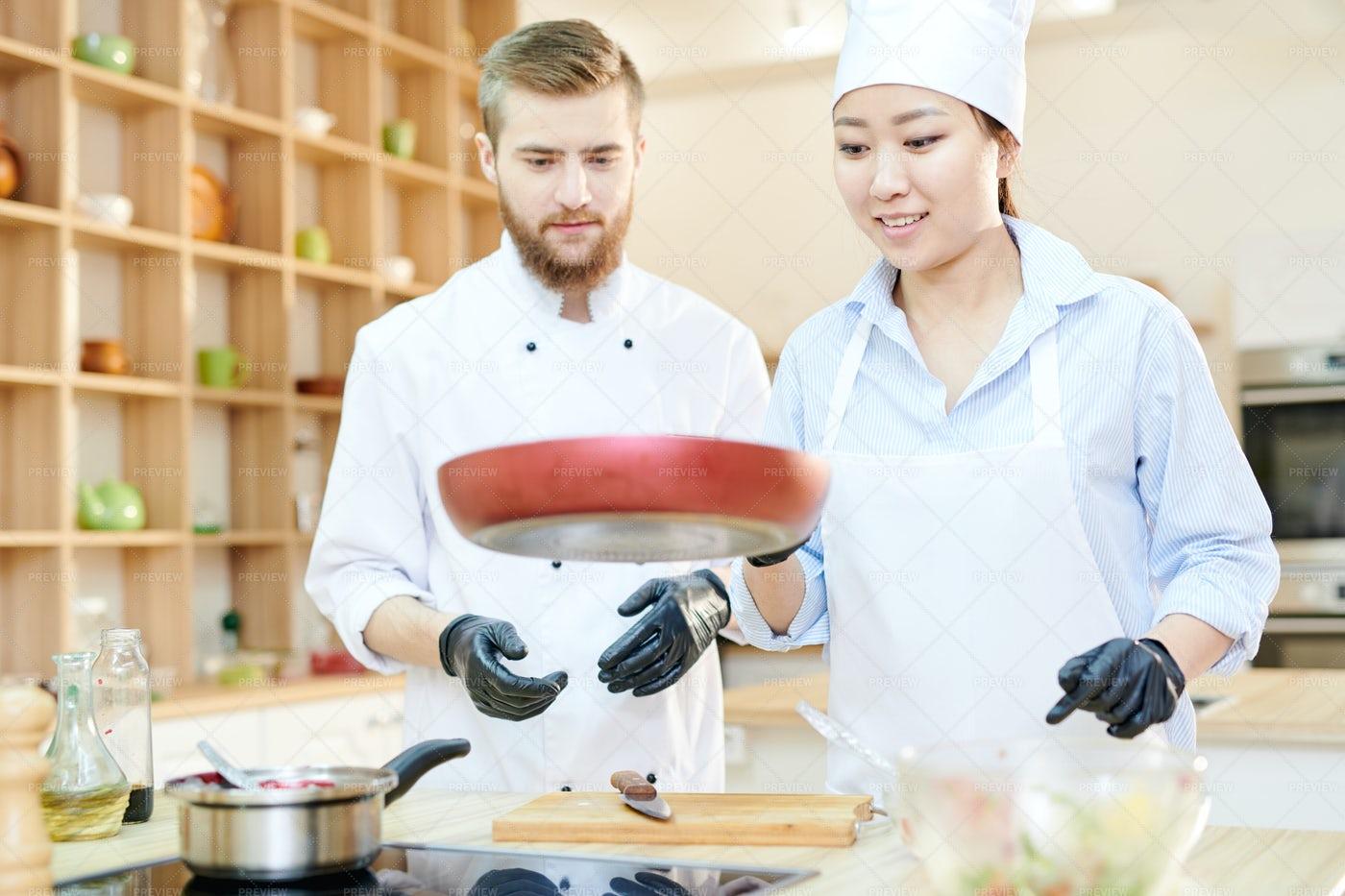 Cheerful Chefs Working In Kitchen: Stock Photos