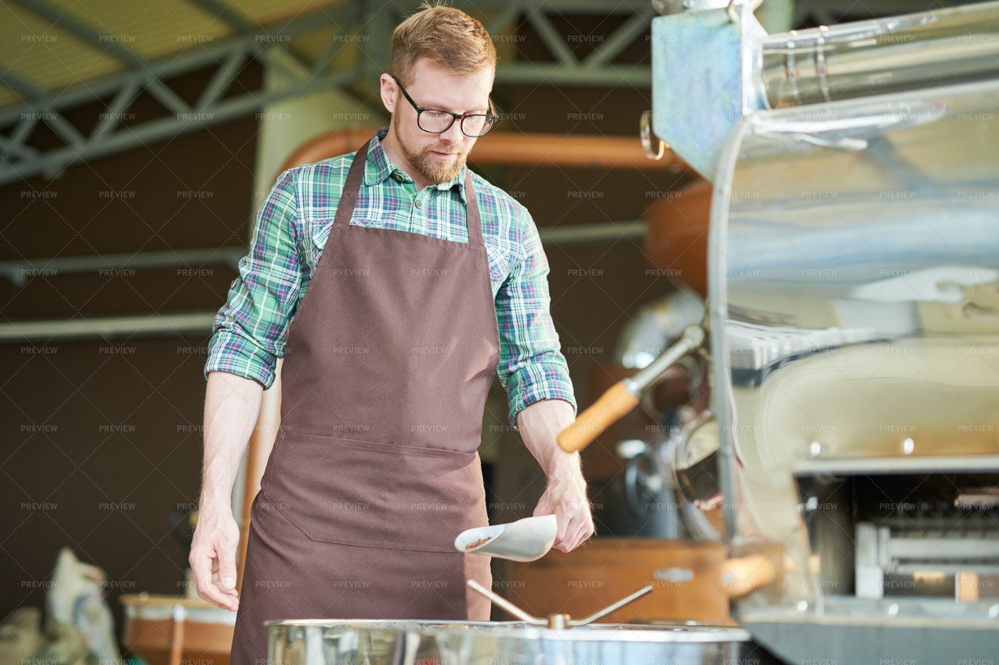 Modern Young Man Roasting Coffee: Stock Photos