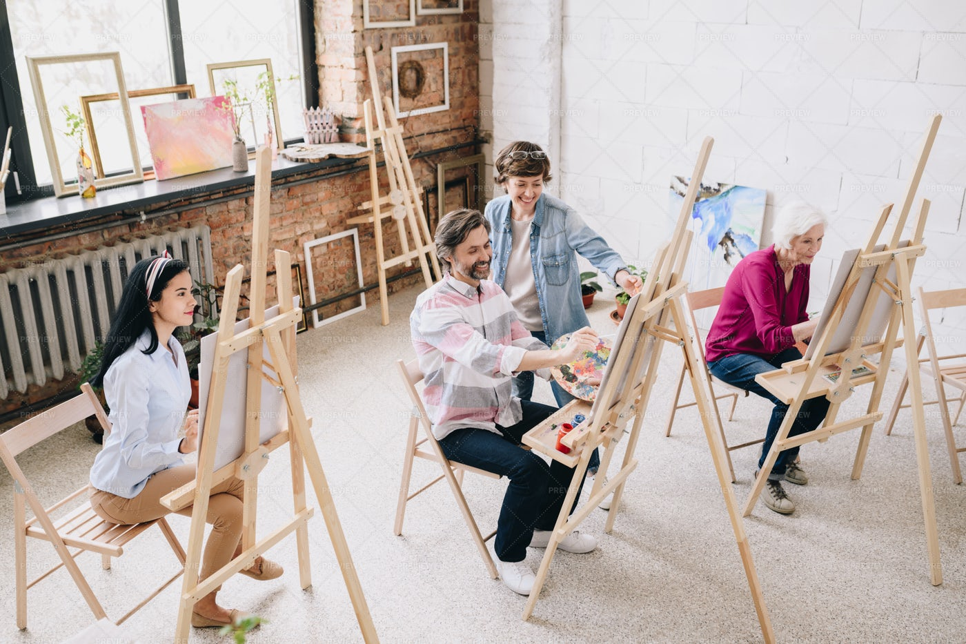 Students Painting At Easels In Art...: Stock Photos