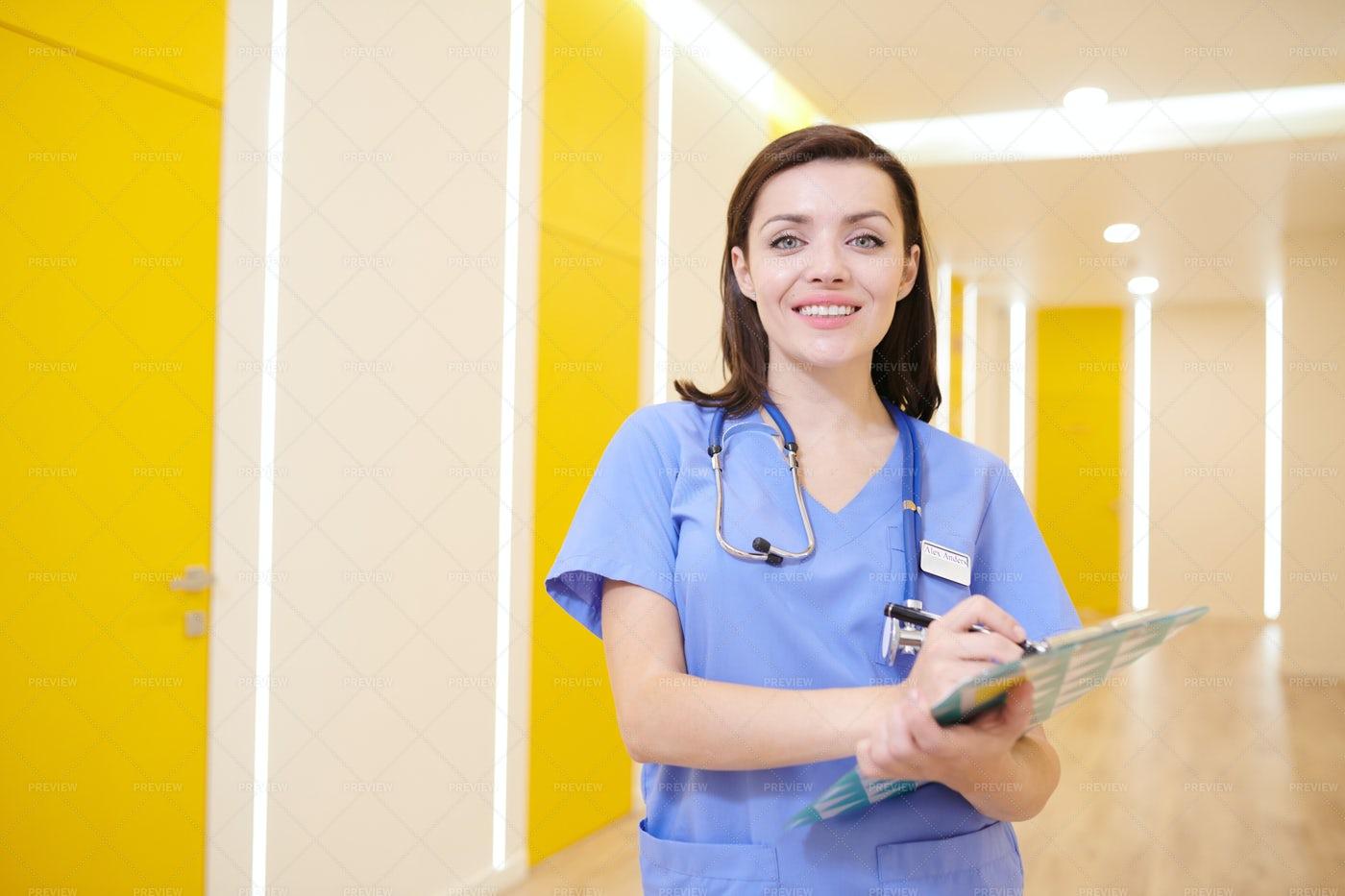 Cheerful Nurse Posing In Clinic: Stock Photos