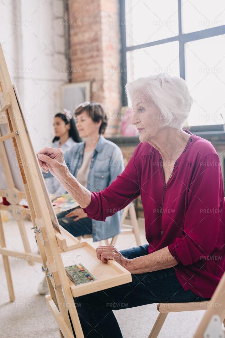 Artists Sitting In Row In  Studio: Stock Photos