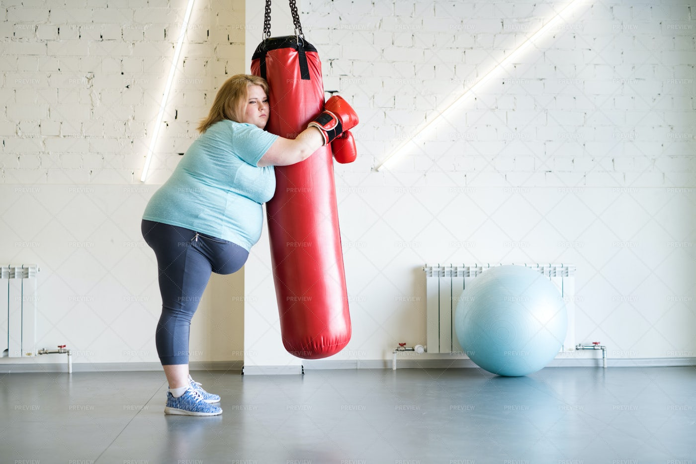 Sad Obese Woman Training In Gym: Stock Photos