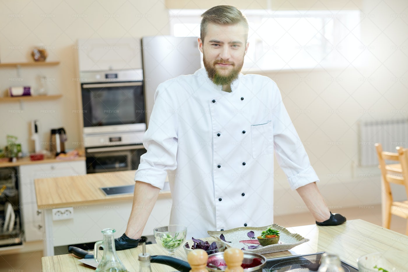 Handsome Chef Posing In Kitchen: Stock Photos